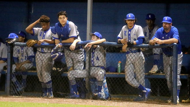 La Vergne baseball players watch a recent game .The Wolverines knocked off Siegel 7-4 in the District 7-AAA Tournament Saturday.