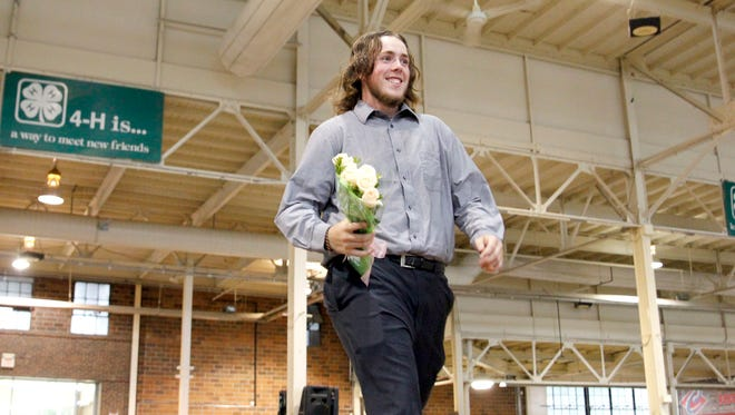 Sam Haines of Runnells strut his stuff after being named the Polk County Fair King.