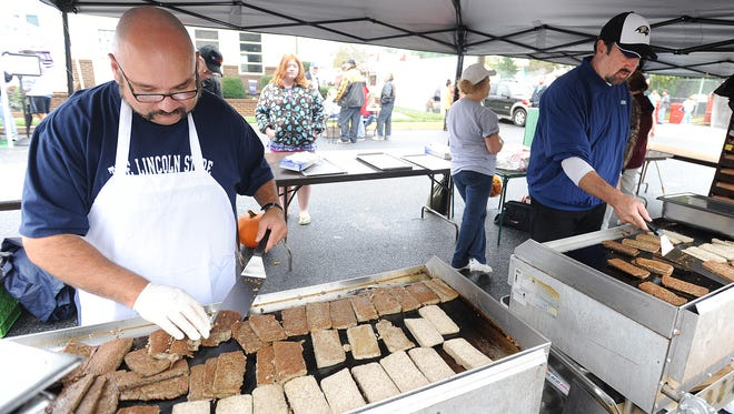 A volunteer cooks scrapple at the 2012 Apple-Scrapple Festival in Bridgeville.