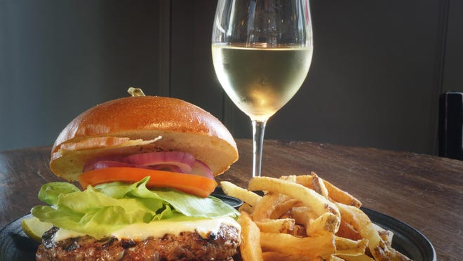 The Classic Burger and a glass of Flume Blanc are on the menu at Cork and Rye Gastropub.