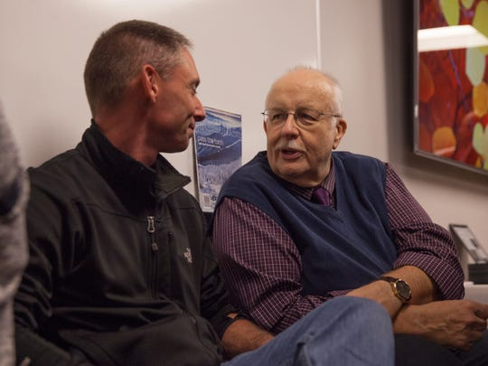 Former Burlington Police Chief Michael Schirling, left, speaks with Mike Donoghue at a retirement party for six Free Press employees.