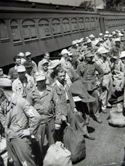 German prisoners of war arrive by train at Camp Shanks