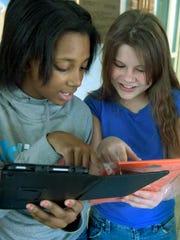 Goode Elementary School sixth-graders Aaliyah Ushry,