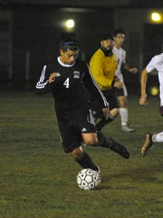 Mission Oak's Diego Alvarado dribbles the ball down field against Mt. Whitney in Thursday's non-league match at Mt. Whitney.