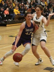 Indianola senior Grace Berg drives toward the basket.