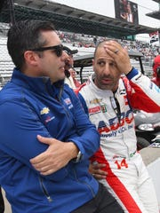 A.J. Foyt Enterprises IndyCar driver Tony Kanaan (14) talks with Larry Foyt during fast friday practice for the 102nd running of the Indianapolis 500 at Indianapolis Motor Speedway on Friday, May 18, 2018.
