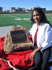 Ajee' Wilson shows off the rock dedicated in her honor. The rock will be placed at the entrance of the high school track in the Reynold Athletic Complex.