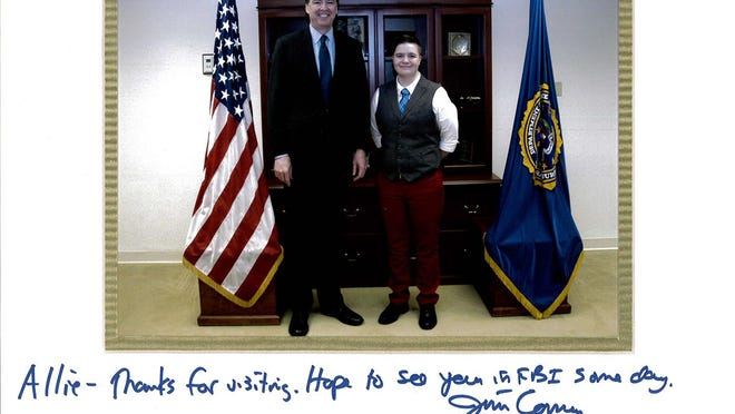 Allie DeGroot of Oshkosh stands with FBI Director James Comey in his Washington, D.C., office earlier this year.