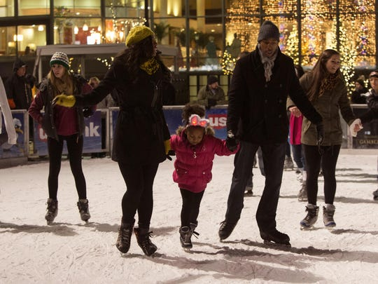Skaters enjoy skating during ceremonies for the Annual Tree Lighting Ceremony at Fountain Square in 2013.