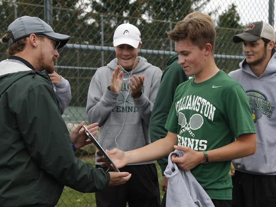 Williamston's Oliver Weaver, right, gets an award for