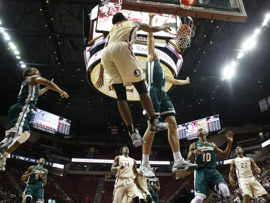 FSU's Malik Beasley dunks the ball over Southeastern
