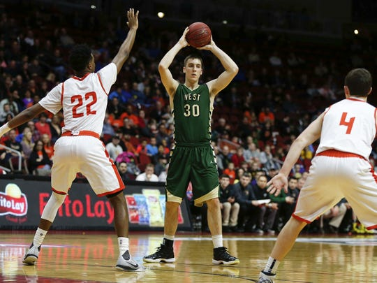 Iowa City West's Connor McCaffery, pictured in last year's state basketball tournament, would like to play baseball in college as well if possible.