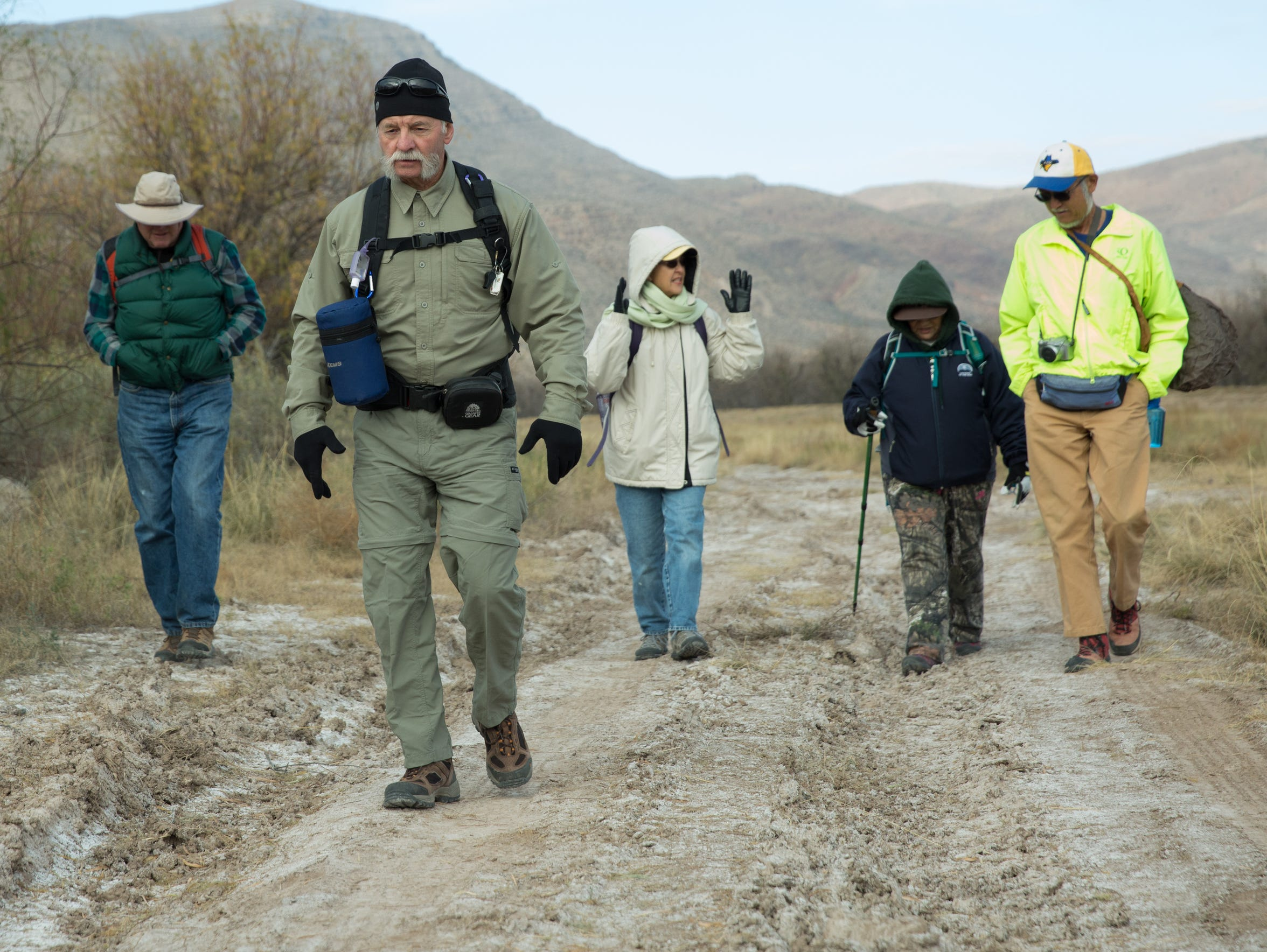 A group of hikers participate in a hiking group meant