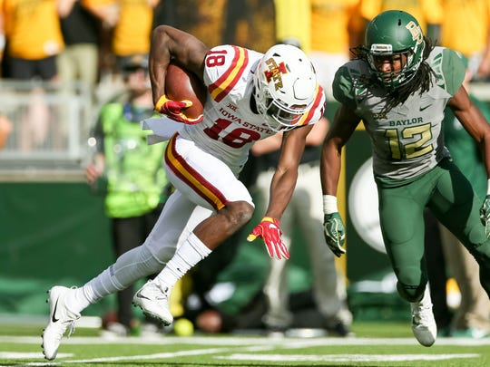 Nov 18, 2017; Waco, TX, USA; Iowa State Cyclones wide receiver Hakeem Butler (18) makes a touchdown reception with Baylor Bears safety Davion Hall (12) at McLane Stadium. Mandatory Credit: Andrew Dieb-USA TODAY Sports