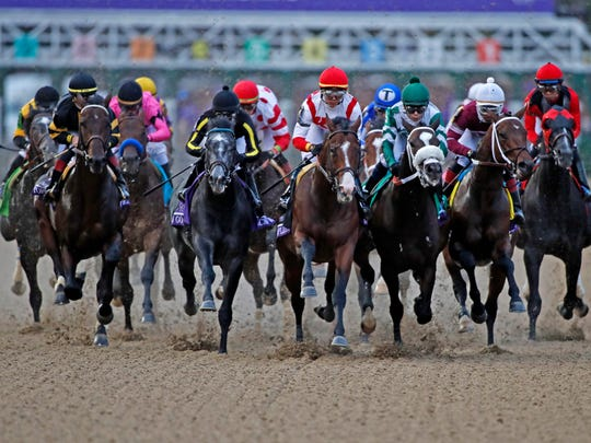 Horses run down the front stretch during the Sentient