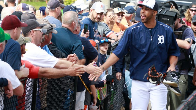 Tigers pitcher David Price, followed by an MLB camera crew, slaps hands with fans as he walks out to the practice fields for the team's first full squad workout on Tuesday in Lakeland.