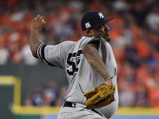 New York Yankees starting pitcher CC Sabathia throws during the first inning of Game 7 of baseball's American League Championship Series against the Houston Astros Saturday, Oct. 21, 2017, in Houston.