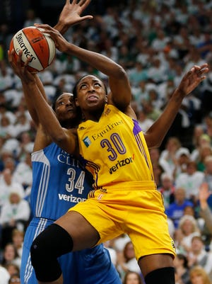 Los Angeles Sparks forward Nneka Ogwumike (30) shoots the ball against Minnesota Lynx center Sylvia Fowles (34) in the first half of Game 1 of the WNBA basketball finals Sunday, Oct. 9, 2016, in Minneapolis. (AP Photo/Stacy Bengs)