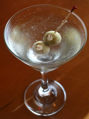 A dirty martini with blue cheese-stuffed olives from Mezzodi's. Martinis are $5 all day every day.