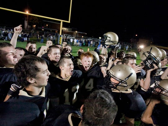 Delone Catholic players celebrate their YAIAA Division III win over Biglerville on Friday. The Squires handed the Canners their first loss of the season, 43-28. (The Evening Sun -- Shane Dunlap)