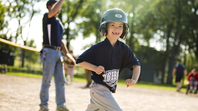 Bryson Coronado, 8, of Port Huron, looks to the stands as he runs to first during a Marysville Little League Challenger Division baseball game Thursday, July 2, 2015 at Marysville Municipal Park.