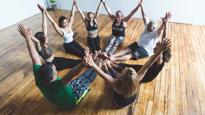 Yoga instructor Vineeta Singh leads at Yoga Class at her Kilburn Mill studio, The Yogaguru. The coronavirus pandemic forced Singh to permanently close the studio earlier this year.