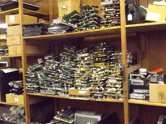 Circuit boards are stockpiled for spares at the TV & Radio Clinic in Kingsport, Tenn. This year marks its 50th year in business operated by the Darnell family.  (Rick Wagner/The Kingsport Times-News via AP)