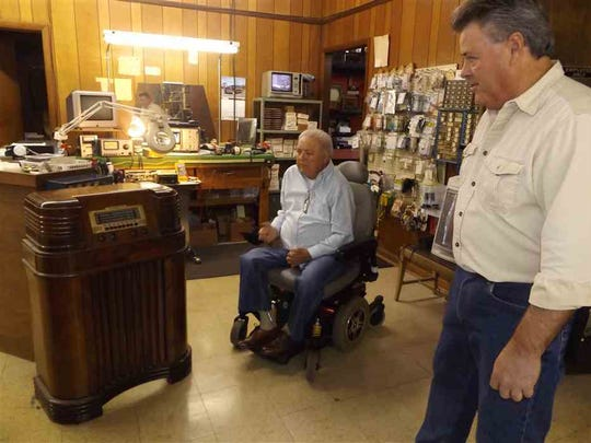 Billy Darnell, left,  and son Gary look at a 1940 Philco radio the elder Darnell restored years ago at the shop in Kingsport, Tenn. Gary Darnell has worked at TV & Radio Clinic in Kingsport, Tenn. since 1979 and took it over when his father retired in 1999 after opening it in 1967. The company is marking its 50th anniversary. (Rick Wagner/The Kingsport Times-News via AP)