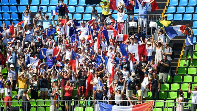 French supporters attend the medal ceremony for the round 2 of the Equestrian Jumping team at the Olympic Equestrian Centre in Rio de Janeiro, Brazil.