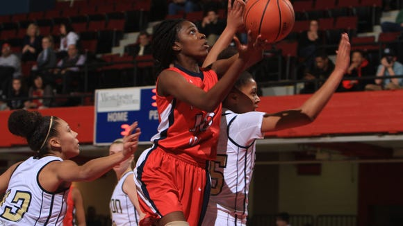 Peekskill's Shaina Iton drives to the basket against Beacon during the Section 1 Girls Class A semifinal basketball playoff game at the Westchester County Center in White Plains Feb. 26, 2014.