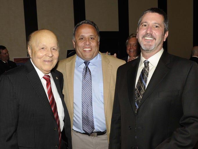 Herb Santos Sr., left, Herb Santos Jr. and Steve Baker attend the Nevada Justice Association Gala Tuesday June 10, 2014 at the Atlantis.