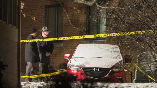 State police stand on the scene during an investigation into a shooting that occurred on Wednesday, Dec. 13, 2017 at Penn State University Beaver Campus in Monaca, Pa. A woman who worked at the Penn State satellite campus apparently was shot dead by her estranged husband in the university parking lot, and the man then killed himself, police said. (Haley Nelson/Pittsburgh Post-Gazette via AP)