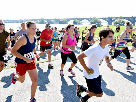 About 50 participants take-off at the start of the fifth annual Susquehanna Biathlon in Wrightsville, Pa. on Saturday, Aug. 15, 2015. Proceeds from the event are used for the improvement of rivers and creeks. Dawn J. Sagert - dsagert@yorkdispatch.com