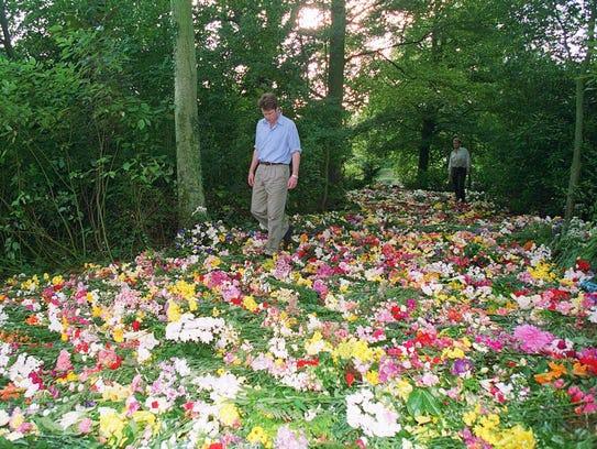 Princess Diana's brother, Earl Spencer, walks through