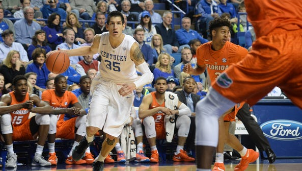 UK's Derek Willis drives with the ball during the University