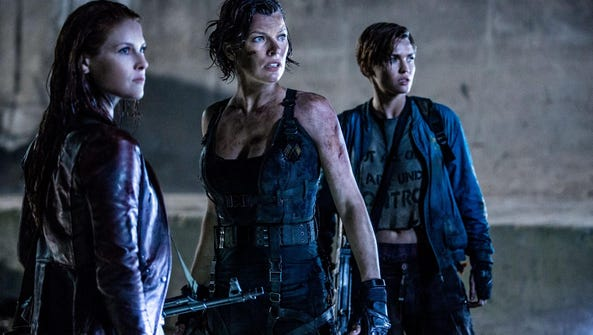 Girls just want to have gun: Milla Jovovich (center)