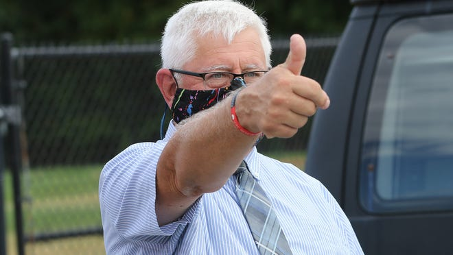 Retiring Needham DPW head Rick Merson gave a thumbs-up to a recent drive-by parade in his honor. Merson lives in Natick.