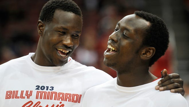 UofL's Mangok Mathiang (left) and Akoy Agau (right) share a light moment before the Cardinals take on Western Kentucky on Saturday at the KFC Yum! Center. Dec. 14, 2013