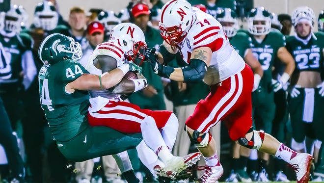 MSU's Marcus Rush sacks Nebraska quarterback Tommy Armstrong Jr. in the second quarter Saturday at Spartan Stadium