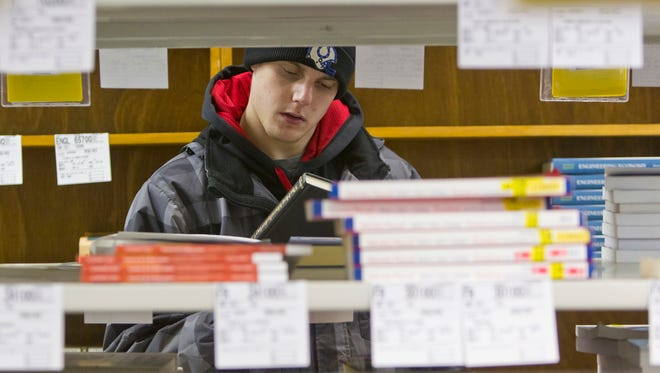 Colton Pulaski, a student in Industrial Technology at Purdue University, looks for a book at the Purdue University bookstore in West Lafayette, Ind.