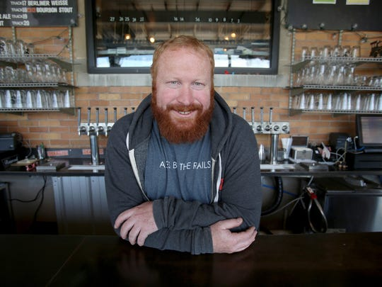 The Filling Station head brewer Andy Largent at the outside bar at the brewery and restaurant in Traverse City, Michigan on May 26, 2017.The popular place for locals and tourist is located inside a former train depot in the city.