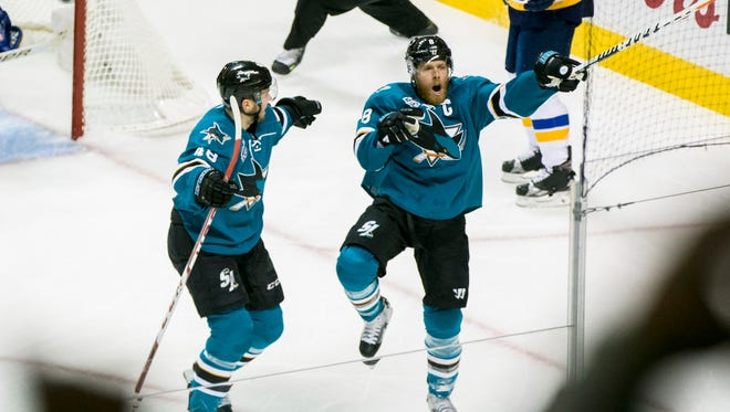 San Jose Sharks center Joe Pavelski (8) celebrates his goal against the St. Louis Blues in the first period of Game 6 in the Western Conference Final of the 2016 Stanley Cup Playoffs at SAP Center.