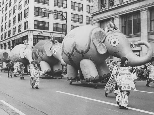 Pudgy pachyderms touting the Indianapolis Zoo capture the hearts of young folks attending the 1962 Christmas Parade.