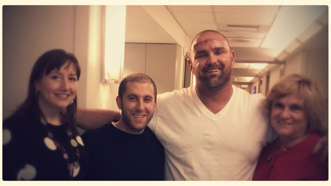 Chris Hahn at the hospital after having his brain tumor removed, with his mom, Maryann Carey, and two members of the University of Pittsburgh trauma study team.