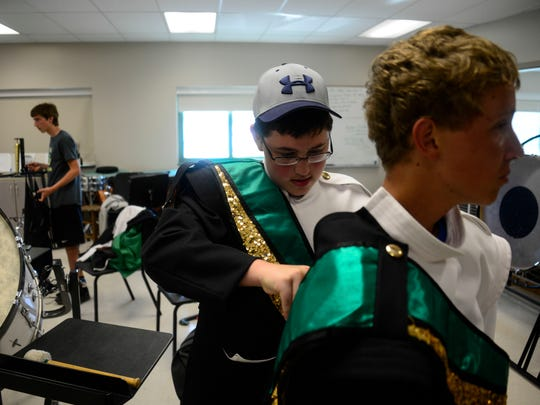 The Vestal Marching Band tries on their uniforms for the first time.