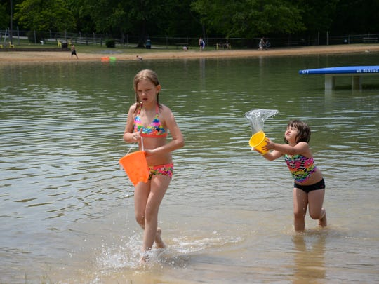 Serenity Simmons, 10, and Willow Branch, 4, both of Stuarts Draft, enjoy the lake at Shenandoah Acres on Sunday, May 25, 2014.