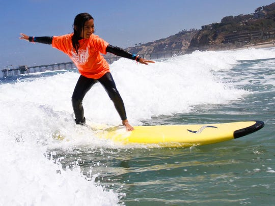 Save $85-$210 on surf lessons for kids 16 and younger at Surf Diva Surf School in La Jolla, Calif., in October.