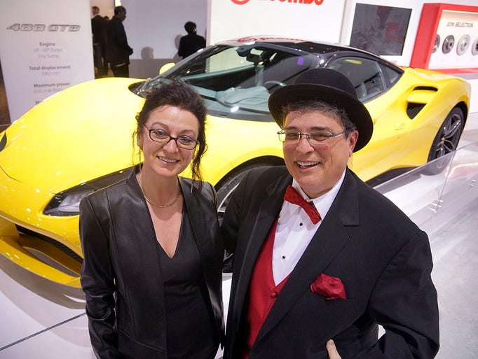 Elena Manalp and Beth Bashert pose in front of a Ferrari