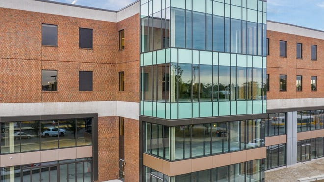 Exchange 200, a four-story, 310,000-plus square-foot mixed-use building in Malden Center, is now complete.