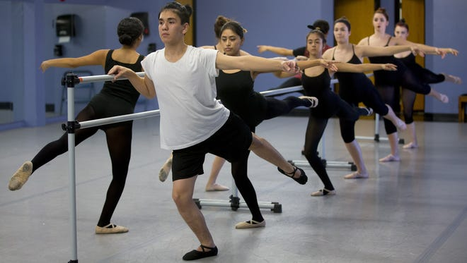 Matthew Mendez, 15, right,  and classmates dance in Ballet Repertory class at Metropolitan Arts Institute in Phoenix on Thursday, October 1, 2015.
